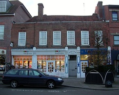 34 and 36 High Street - Grade II late 18th-century brick building with sash windows, two chimneys and a tiled roof.