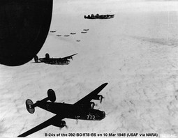 Consolidated B-24 Liberators of the 392d Bomb Group on a mission over enemy-occupied territory