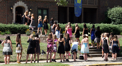 Students line up in front of the Alpha Xi Delta house at Purdue University during recruitment.