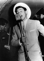 Berlusconi singing on a cruise ship in the 1960s.[25]