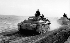 German Panzer III of the Afrika Korps advancing across the North African desert, 1941