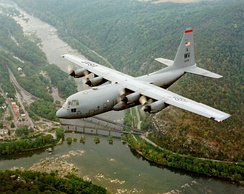 West Virginia ANG C-130H Hercules flying over Harpers Ferry, West Virginia, the junction of the Potomac and Shenandoah (left) rivers.