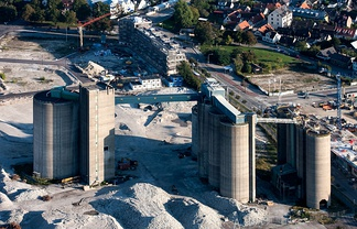 Cement factories are part of the manufacturing industry. This factory is in Malmö, Sweden.