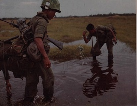 Thai soldiers wash in a small pool during a break in operations, Nhon Trac, 19 October 1967
