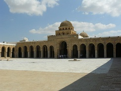Example of a religious building: the Great Mosque of Kairouan (also called the Mosque of Uqba), founded in 670, dates in its present state principally from the 9th century. The Great Mosque of Kairouan is located in the city of Kairouan, Tunisia.