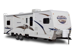 Side view of a 2011 Sundance travel trailer, built by Heartland Recreational Vehicles