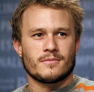 A headshot of Heath Ledger as he looks away from the camera