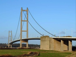 The Humber Bridge was designed based on ideas by Sir Ralph Freeman before the 1950s, then Sir Gilbert Roberts in 1955 and 1964, and a final complete design by Bernard Wex. It was made with a significant amount of ground granulated blast-furnace slag.