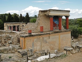 Restored North Entrance with charging bull fresco of the Palace of Knossos (Crete), with some Minoan colourful columns