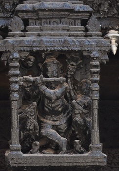 Temple car carving of Krishna playing flute, suchindram, Tamil Nadu, India