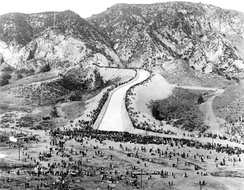 Crowds gather to see the first water reaching the valley via the new aqueduct.