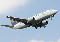 The Boeing 737-300, part of the Boeing 737 family is the most produced jet aircraft that is still operating.