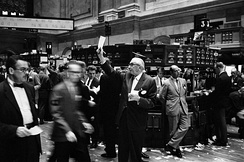 NYSE's stock exchange traders floor before the introduction of electronic readouts and computer screens.