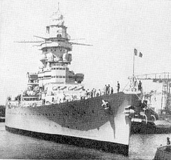 A very modern Dunkerque-class battleship battleship commissioned in 1937, Strasbourg was potentially a quite substantial threat to British control of the sealanes were she to fall into Axis hands.