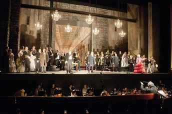 Performers from the Atlanta Opera sing the finale of Lucia di Lammermoor. The opera orchestra is visible in the lowered area in front of the stage.