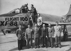 The engineering team stands after Flight 100.
