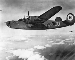 328th Bomb Squadron Consolidated B-24J-55-CO Liberator Serial 42-99949 on a mission to Friedrichshafen Germany during August 1944. This aircraft was lost over Belgium on 21 September 1944, MACR 9662