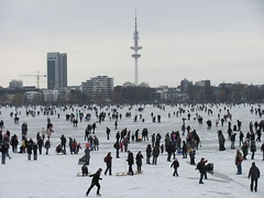View over frozen Alster towards Radisson Hotel and Hertz-Turm