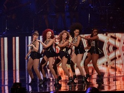 "Beyoncé and her background dancers performing a choreography during ""Crazy in Love"""