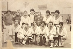Hastert (top left) while he was a high school wrestling coach in 1976