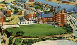 An old postcard image of Duquesne's campus shows the Old Main building, the university chapel, and Canevin Hall.