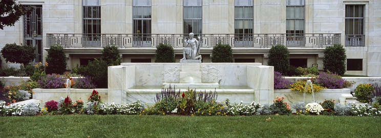 An aluminum casting of Brenda Putnam's original statue of Puck stands in the west garden of the Folger Shakespeare Library.