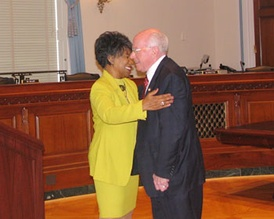 Ranking member Millender-McDonald is greeted by Chairman Vern Ehlers at a hearing of the House Administration Committee.