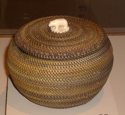 Inupiat baleen basket, with an ivory handle, made by Kinguktuk (1871–1941) of Barrow, Alaska. Displayed at the Museum of Man, San Diego, California.