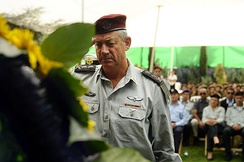 Israel Defense Forces Chief of Staff Lt. Gen. Benny Gantz salutes Yom Kippur War casualties at an official annual memorial service.