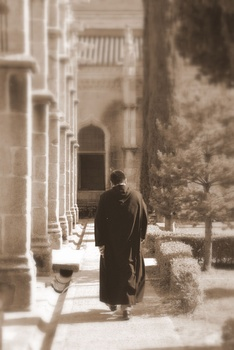 A monk walking in a Benedictine monastery