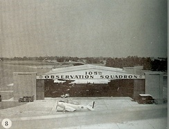 105th Airlift Observation Squadron hangar with Curtiss O-52 Owl