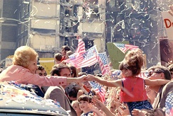 Pat Nixon reaches out from her limousine to a young girl during an October 1972 campaign stop in Atlanta.