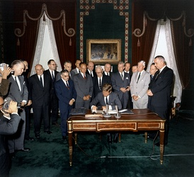 October 7: President Kennedy signs the Partial Test Ban Treaty, a major milestone in early nuclear disarmament in the Nuclear Age.