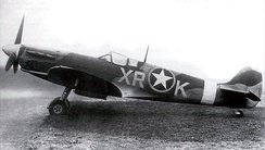 Spitfire MK V of the 334th Fighter Squadron, 4th Fighter Group in 1942. Note the RAF 71 Eagle Squadron markings on the fuselage with the USAAF emblem overlaid over the RAF roundrel.