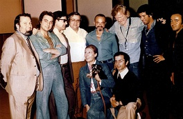 Astor Piazzolla with Gerry Mulligan at the Summit recording, Milan (Italy) 1974. The image includes the producer Aldo Pagani, first from the left, and some performers, including Pino Presti, 2nd from right, and Tullio De Piscopo, 2nd from left