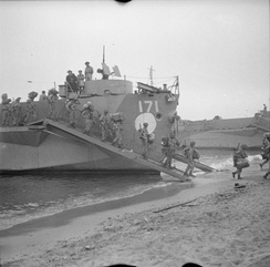 British Troops coming ashore from landing ships at Reggio, 3 September 1943.