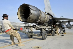 View of a jet engine being pulled out of an F-16