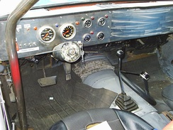Quick release hub and the detached steering wheel on the floor, used mainly in race cars