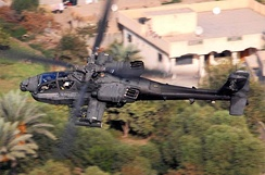 AH-64D Apache flying over Baghdad, Iraq in 2007, on a reconnaissance mission