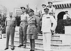 Allied leaders in the Sicilian campaign. General Dwight D. Eisenhower meets in North Africa with (foreground, left to right): Air Chief Marshal Sir Arthur Tedder, General Sir Harold Alexander, Admiral Sir Andrew Cunningham, and (top row): Mr. Harold Macmillan, Major General Walter Bedell Smith, and unidentified British officers.