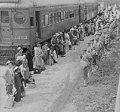 Japanese Americans arrive for Internment processing.