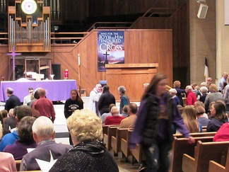 A Lutheran pastor distributes ashes during the Divine Service on Ash Wednesday.