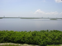 Looking east, left-right: LC-41, LC-40, (center) LC-37B, Harrison Island, Vertical Integration Facility, and the ITL Warehouse on CCAFS in 2005