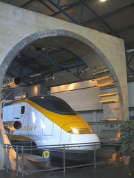 The Channel Tunnel exhibit at the National Railway Museum in York, England, showing the circular cross section of the tunnel with the overhead line powering a Eurostar train. Also visible is the segmented tunnel lining