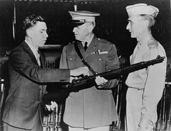 John Garand points out features of the M1 to army generals.