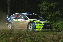 Hirvonen driving a Ford Focus RS WRC 06 at the 2006 Rally Japan.