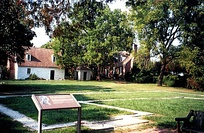 Foundation outline (foreground) marking Washington's birthplace, near the memorial house (right rear)