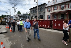 Governor of Maryland Larry Hogan tours Ellicott City, viewing damage left by the 2016 floods, accompanied by county executive Allan Kittleman.