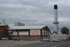 Heinz, although based in Hayes in Middlesex, has the largest food processing complex in Europe at a 55-acre (22 ha) site at Kitt Green in Wigan, which produces 1.4 billion cans of food each year; it is accessed to the east of the Orrell Interchange of the M6 (A577); the 38-acre Heinz NDC is next door