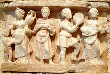 Hellenistic culture in the Indian subcontinent: Greek clothes, amphoras, wine and music. Detail from Chakhil-i-Ghoundi Stupa, Hadda, Gandhara, 1st century AD.